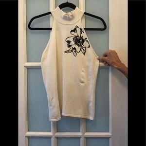 Cache sleeveless top